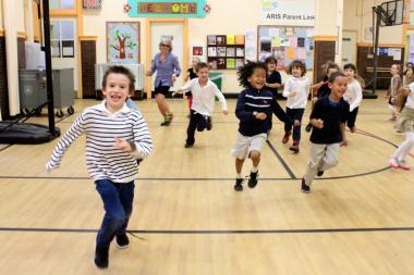 Students from P.S. 110 have an exercise class on the school's newly installed gym floor.