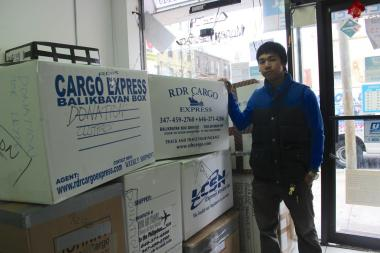 Rommel Del Rosario, who runs a shipping business in Woodside, collected donations for victims of Typhoon Haiyan.