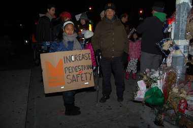 Families marched and held signs at the rally for safer streets in Jackson Heights and Corona last November. A pedestrian safety iniative last Sunday handed out dozens of violations and summonses to cars — and bicyclists.