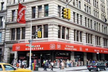 The Strand Book Store pulled down signs warning of nightly sprinkler use after a reporter asked about the process, which staffers called a way to drive away the homeless.