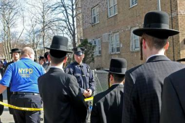 Hasidic residents earlier this year protested the burning of mezuzahs at the Taylor-Wythe Houses.
