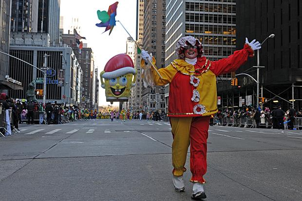 The Thanksgiving Day Parade brought giant balloons down Sixth Avenue, Nov. 28, 2013.