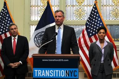 Mayor Bill de Blasio, center, and City Planning Commissioner Carl Weisbrod, left, are pushing a city-wide zoning change that was met with vehement opposition at a public hearing.