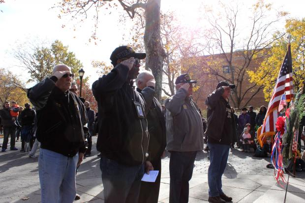 Residents and veterans in Carroll Gardens commemorated Veteran's Day in front of a World War I memorial in Carroll Park on Monday.