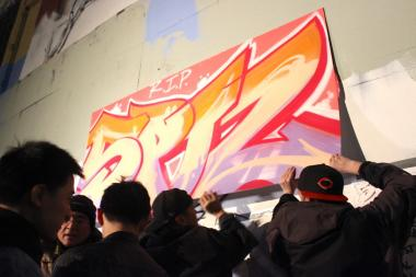 A crowd gathered at the Long Island City site to mourn the art that was painted over Tuesday morning.