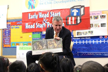 Mayor-elect Bill de Blasio reads a book to preschoolers ahead of announcing his universal pre-kindergarten working group on Dec. 3, 2013.
