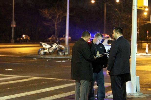 A pedestrian and a motorcyclist were both killed in a crash on Queens Boulevard on December 22, 2013.