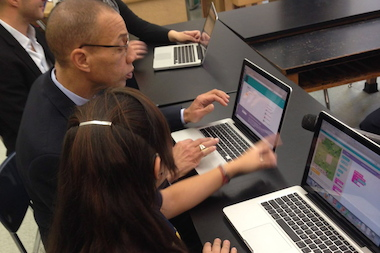 Schools Chancellor Dennis Walcott got a lesson in coding from a student at American Sign Language and English Secondary School in Gramercy on Monday, Dec. 9, 2013.