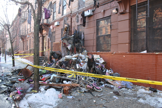 A fire burned through two floors of an East Harlem building early Sunday morning, FDNY officials said.