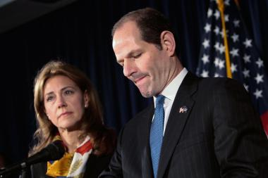 Silda Wall Spitzer stood by Eliot Spitzer when he announced his resignation from the governor's office on March 12, 2008. They announced the end of their marriage on Dec. 24, 2013.