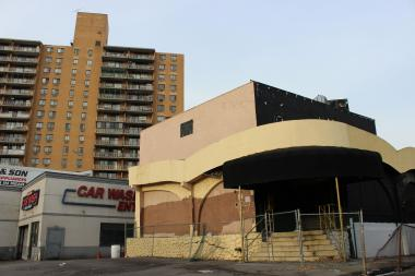 A developer is planning to build a residential tower on the site of a former notorious strip club in Rego Park.