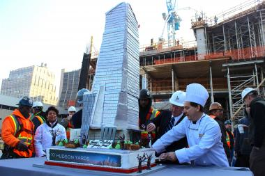 Fairway pastry chef Michael Lewin-Jacus cuts a 5-foot-tall cake in the shape of the first Hudson Yards tower.