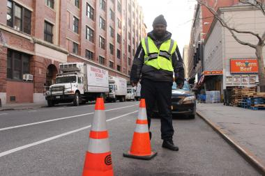 Keeno Campbell is an employee for No Parking Today, which blocks parking on streets scheduled for Con Ed maintenence work.