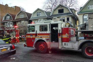 A woman died and her sisters were injured after they were found in a bathroom amid a fire, the FDNY said.