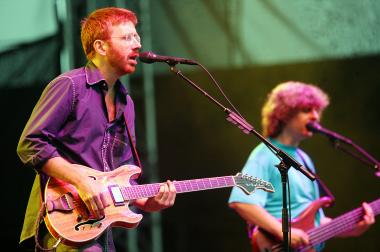 Phish lead singer Trey Anastasio (left) and bassist Mike Gordon perform on stage at Keyspan Park on Coney Island June 17, 2004 in Brooklyn, New York.