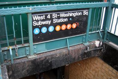 A woman was robbed at the West Fourth Street subway station, police said.