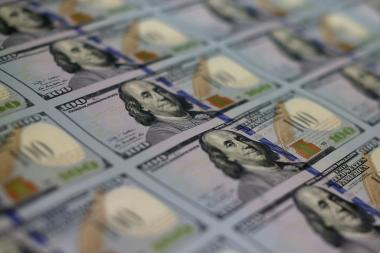 Newly redesigned $100 notes lay in stacks at the Bureau of Engraving and Printing on May 20, 2013 in Washington, D.C. The bills have new security features, such as a duplicating portrait of Benjamin Franklin and microprinting added to make the bill more difficult to counterfeit.