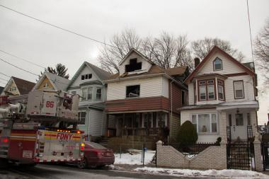 Five people — two residents and three firefighters — were injured in a fire at 134 Harrison Ave. on Friday, Jan. 31, 2014.