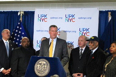 Mayor Bill de Blasio stands alongside labor leaders, including UFT President Michael Mulgrew, who vowed to support his push for a tax increase to pay for universal pre-K at a press conference on Jan. 6, 2013.