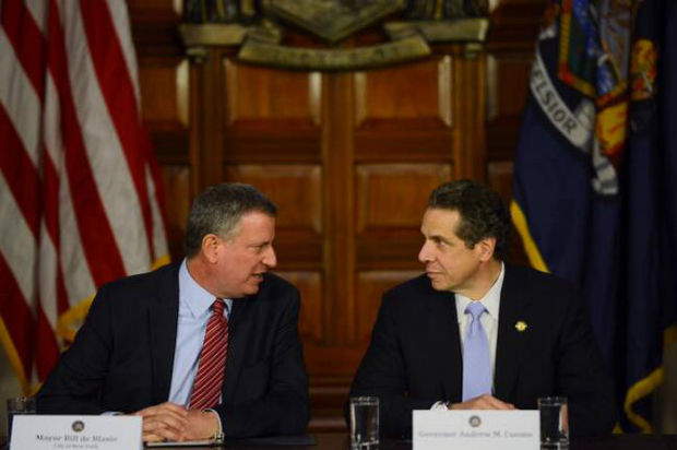 Gov. Andrew Cuomo's CUNY and Medicaid budget proposals may cause problems as Mayor Bill de Blasio develops his own budget.  Here, Cuomo and De Blasio appear at a press conference to discuss Brooklyn hospitals on Jan. 27, 2014.