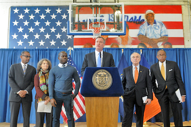 Mayor Bill de Blasio — flanked by (l-r) Center for Constitutional Rights executive director Vincent Warren, New York Civil Liberties Union executive director Donna Lieberman, activist Nicholas Peart, Police Commissioner William Bratton and incoming Corporation Counsel Zach Carter — announces the city's eventual drop of its appeal against a federal stop-and-frisk ruling during a press conference in Brownsville, Brooklyn, Jan. 30, 2014.
