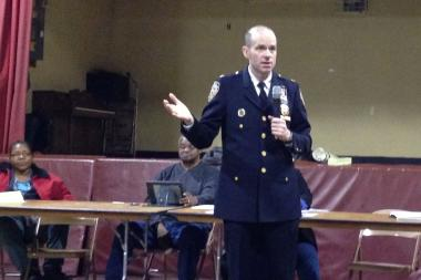 Inspector Charles McEvoy speaks at a community council meeting.