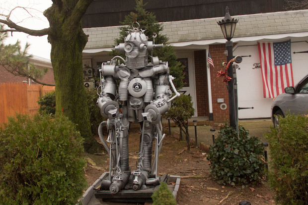 Chris Spollen has put up two huge robots in his front yard and plans to open his home as a gallery.