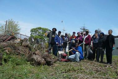 Community members gathered to clean up the lot on the corner of Foch and Merrick boulevards in Jamaica last summer.