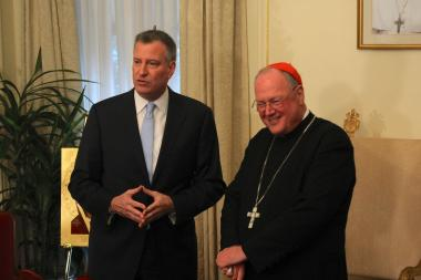 Mayor Bill de Blasio vowed to work with Cardinal Timothy Dolan on issues like affordable housing during a meeting on January 13, 2014.