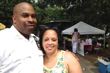 Deputy Inspector Scott Henderson stands with Delia M. Hunley Adossa, president of the 88th Precinct community council, in Fort Greene Park.