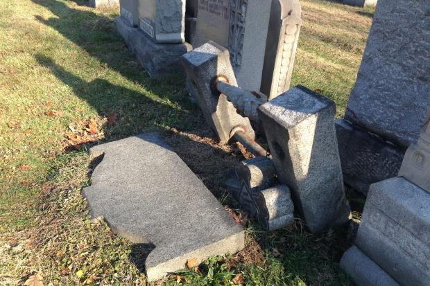 Michael Murno, a 75-year-old Brooklyn architect, had his hip broken when a gravestone fell on him at the Holy Cross Cemetary.