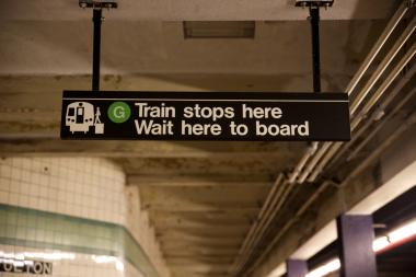 "Newly installed G Train signs read ""G Train stops here. Wait here to board."""