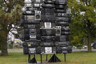 """Got The Power,"" a public art display by Bayeté Ross Smith is made of a towering pile of boomboxes."