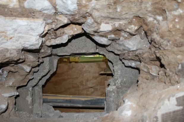Daring thieves broke into the 216th Street Associated by digging a hole through an adjacent building.