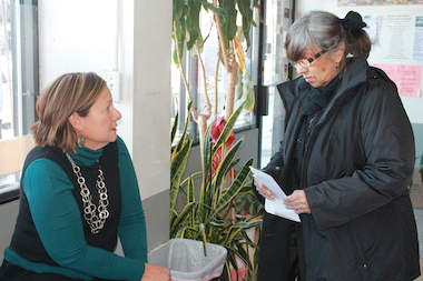 Elvira Castro, Su Casa Travel Bureau's manager (left) gives landlord Elisa Contero, 73, of Hunts Point (right), advice on resolving an issue with Section 8.