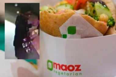 Police were looking for a man accused of impersonating a police officer and stealing a customer's cash at Maoz Vegeterian restaurant on East Eighth Street Dec. 15, 2013.