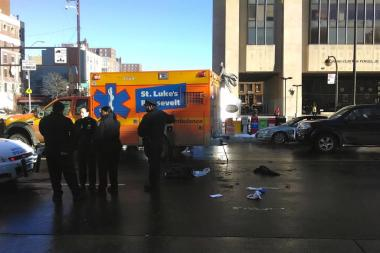 The scene where a man was struck by a black Toyota while crossing 125th Street at Adam Clayton Powell Jr. Boulevard Thursday morning, Jan. 23, 2013.