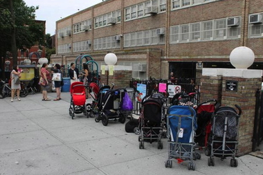 Strollers outside P.S. 321 on the first day of school. P.S. 321 is hosting a panel discussion on gentrification on Jan. 30, 2014.