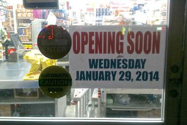 A sign in the window of the old Trade Fair in Jackson Heights said that it would reopen on Jan. 29, 2014.