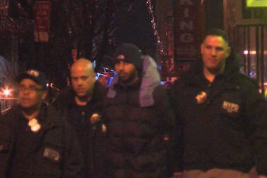 A man was taken into custody by police after a series of fires broke out in two Queens malls Monday.