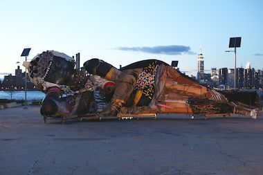 "Polish artist Pawel Althamer's ""Queen Mother of Reality,"" a 50-foot long by 18-foot high sculpture made from steel and discarded scraps, will be on display at Socrates Sculpture Park this spring and summer, the park announced Monday."