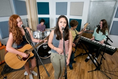 Campers learn to make original rock and pop music at Replay Music Studios.