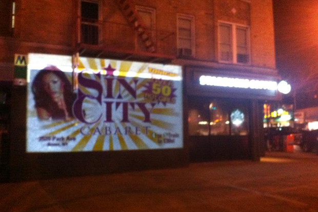 Ads for a Bronx strip club have been projected on a church-owned building on Dyckman Street.