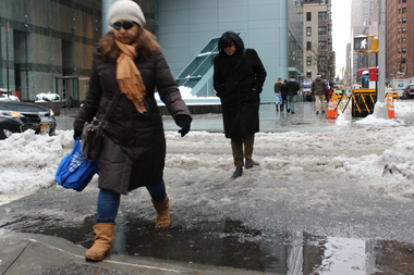Snow, sleet and freezing rain left the city a mess on Wednesday, with train outages and flooded streets.