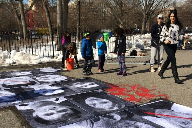 Three women pasted posters of Iranian prisoners on the pavement in Tompkins Square Park on Thursday afternoon.