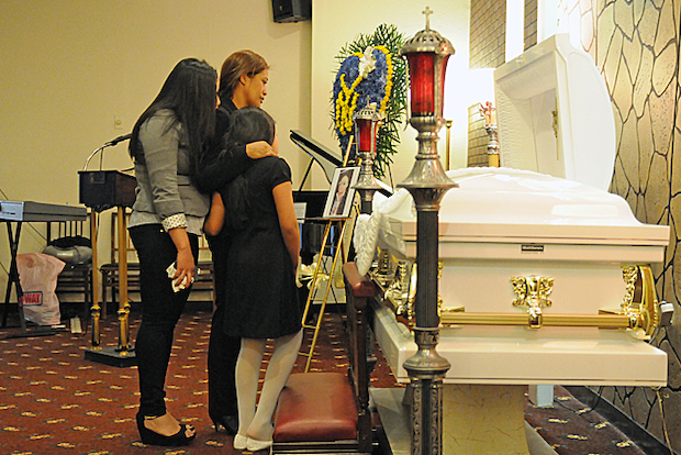 A wake and memorial service were held at the Ponce Funeral Home on Atlantic Avenue Monday for the Angel Rojaz, 39, the father of two shot on a city bus, March 24, 2014.