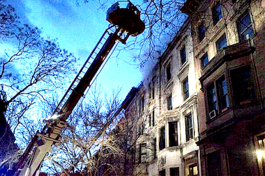 A massive fire engulfed a brownstone apartment building near the American Natural History Museum on West 76th Street on Thursday, March 20, 2014.