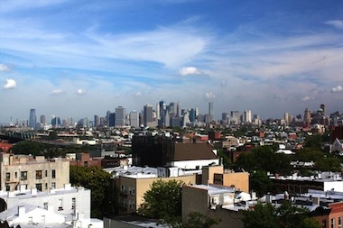 Manhattan skyline view from the roof deck of a Park Slope building.