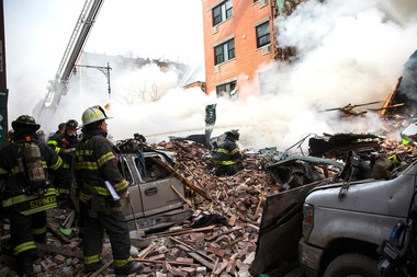 Firefighters respond to a 5-alarm fire and building collapse at 1646 Park Ave. in Harlem on March 12, 2014.