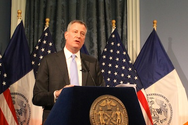 Mayor Bill de Blasio held a roundtable discussion on the state budget with reporters at City Hall on April 1, 2014.